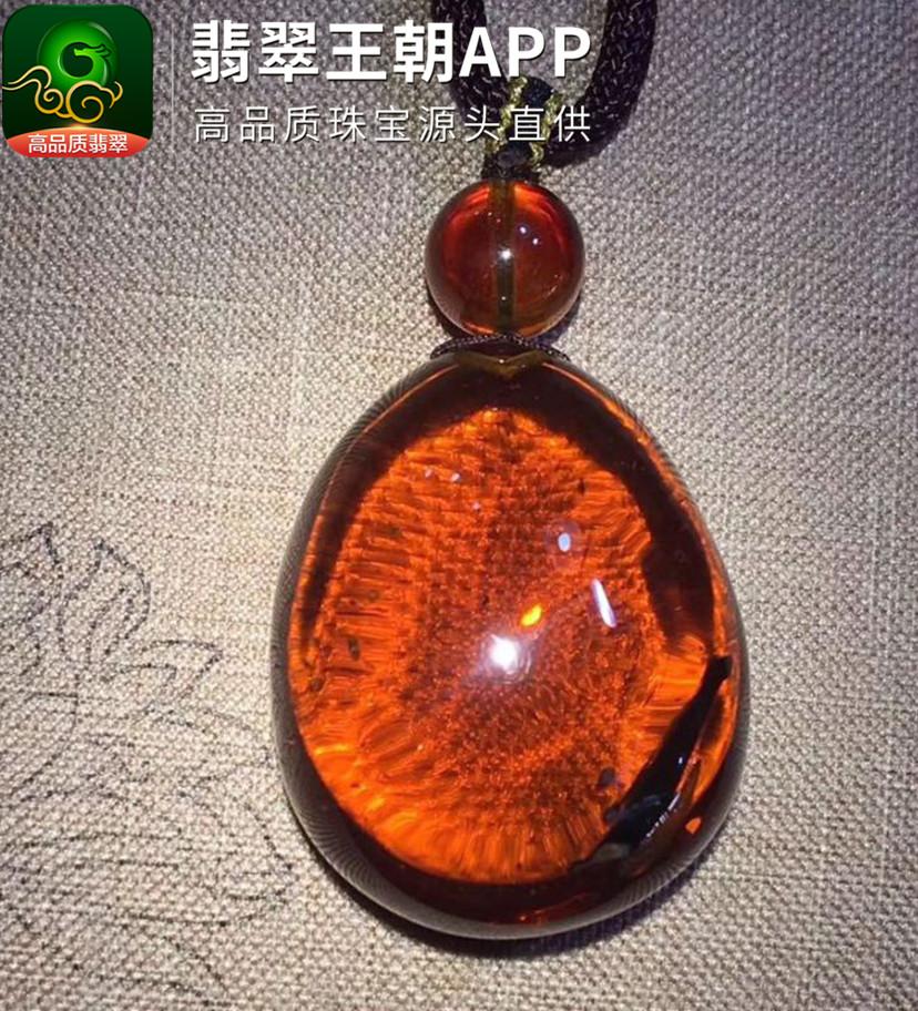 缅甸血红茶珀内含植物蛋面形琥珀挂件